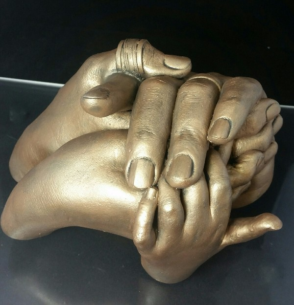 Family Cast Hands Entwined