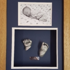 3D baby hand anf foot cast framed with a photo