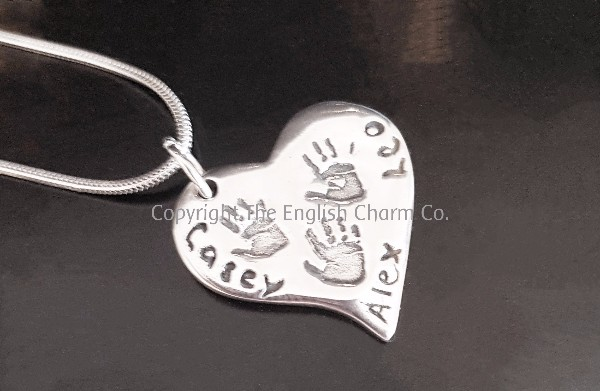 676c47309 A beautiful pendant size 99.9% pure silver charm with multiple prints, in a  shape of your choice with either a handprint, footprint or drawings and  name ...